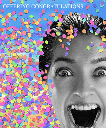 Excited woman with confetti