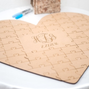 Heart shaped personalized wooden puzzle which doubles as a guestbook