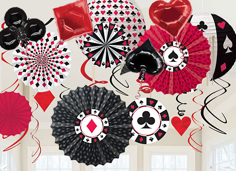 Red black and white ceiling decorations with playing card suit patterns and a casino theme