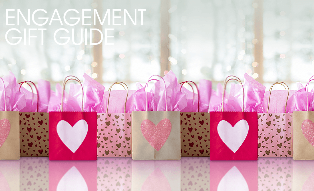 Red and pink gift bags with hearts and pink tissue paper