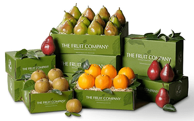 Boxes of pears, oranges and apples