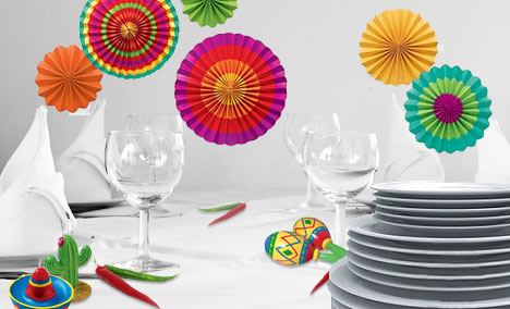 Colorful Mexican accessories white white table cloth and dishes