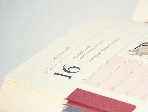 An open book calendar journal