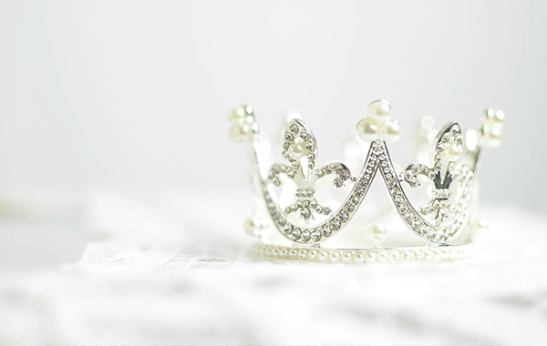 A tiara on a white fur blanket