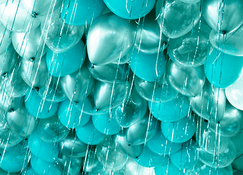 Helium filled Tiffany blue balloons at the ceiling