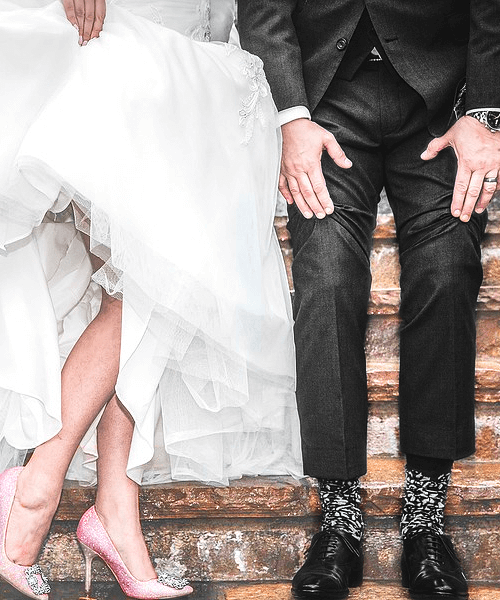 waist down photo of a couple dressed for their wedding