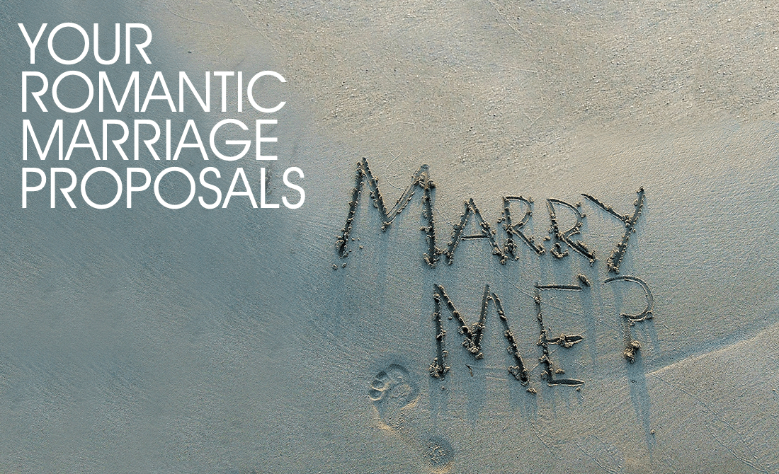 Marry me written in the sand