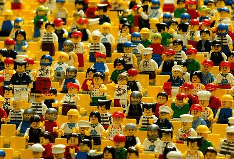 Toy figures on yellow stadium seats