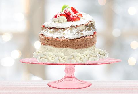 Messy wedding cake on a pink pedestal