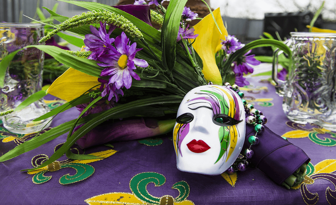 Purple Green and gold decorations and mardi gras mask and beads