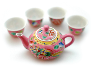 Asian pink teapot with four cups