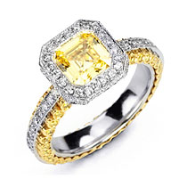 Yellow diamond engagement ring surrounded by white diamonds