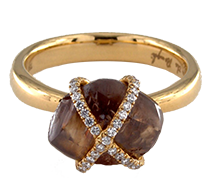 Chocolate diamond with pave white diamonds in a gold setting