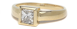 Princess cut bezel set engagement ring in yellow gold
