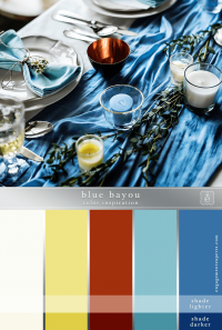 A table setting with blue, deep copper, green and pale yellows.