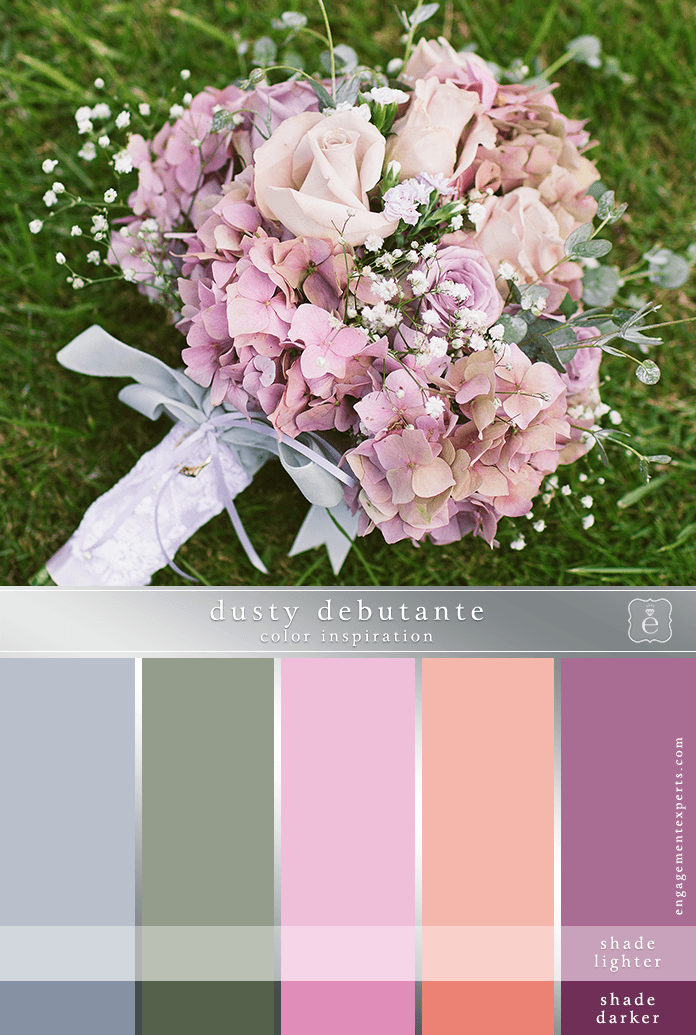 A bridal bouquet in different shades of dusty rose with pale blue and lavender accents and baby's breath