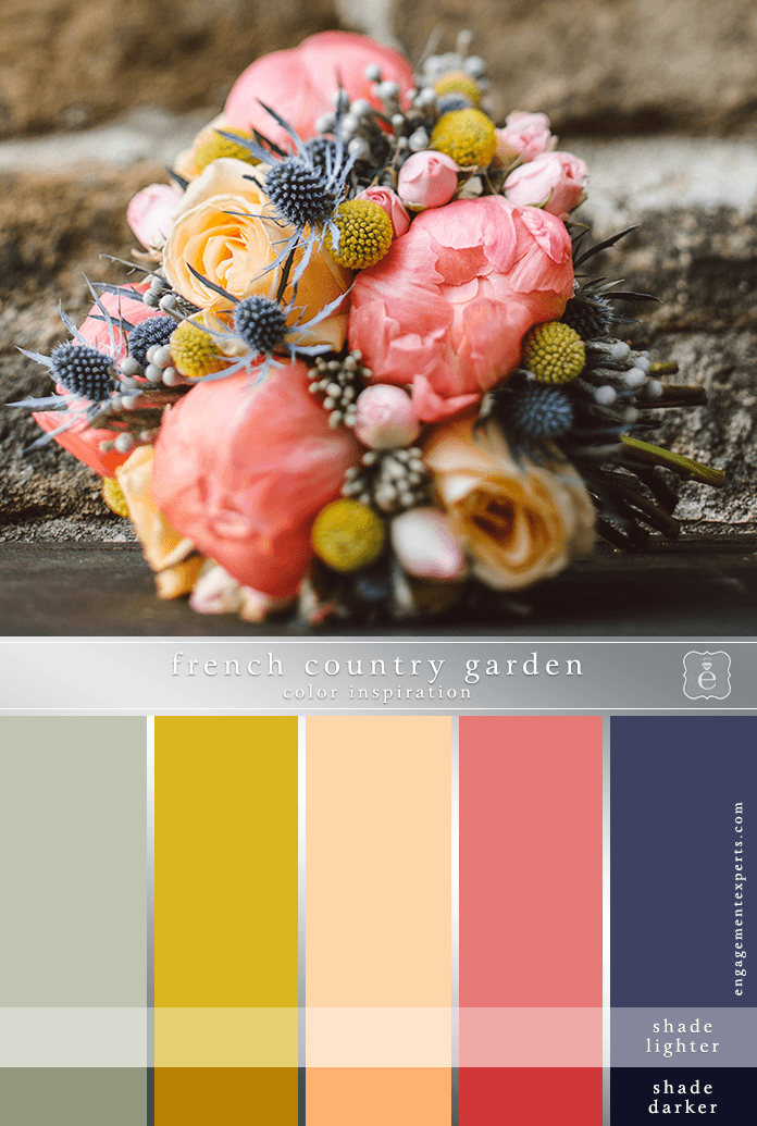 Mauves, gold, and coral floral bridal bouquet in front of an old stone wall