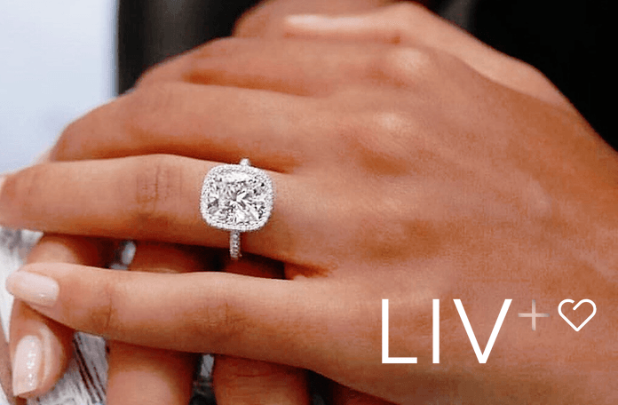 Hand with diamond enggaement ring that fits perfectly