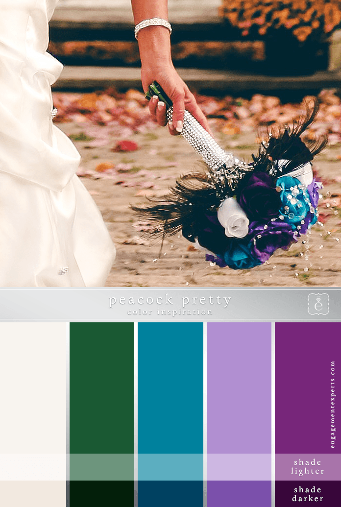 A bride holding a bouquet with pearl handle, peacock feather accents and turquoise, purple and white flowers.